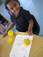 Child playing with play-dough