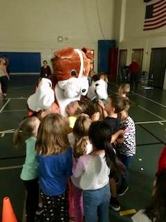 Bulldog mascot surrounded by children