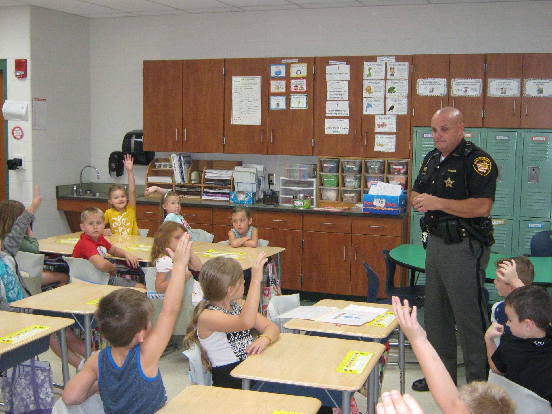 Deputy Rarey answers questions from Mrs. Neal's class
