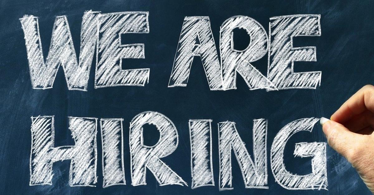 We are hiring written on chalkboard