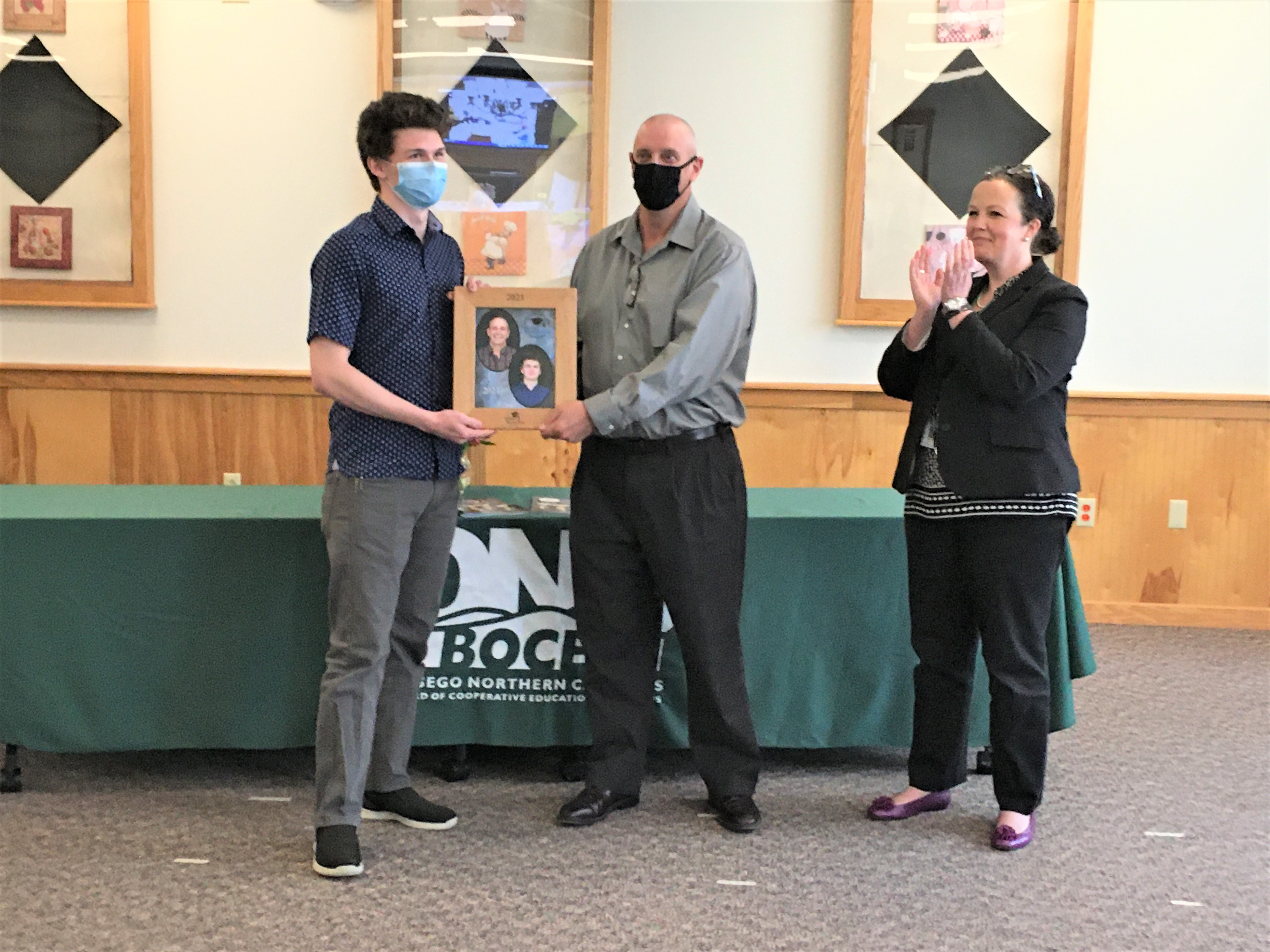 Will Moody receives the Scholar Recognition award from Mechatronics Teacher, Nils Anderson, and District Superintendent, Dr. Catherine Huber